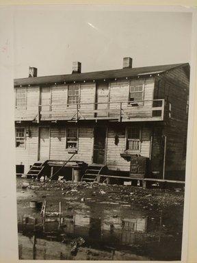 Arthur Rothstein (American, 1915-1985). <em>Houses Inhabited by Oyster Workers</em>, 1939. Gelatin silver photograph, sheet: 10 x 8 in. (25.4 x 20.4 cm). Brooklyn Museum, Gift of Mitchell F. Deutsch, 1995.206.5 (Photo: Brooklyn Museum, CUR.1995.206.5.jpg)