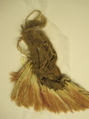 Coastal Wari. <em>Fan, Fragment</em>, 600-1000. Feathers, cotton, bast fibers, 10 × 7 1/2 × 1/2 in. (25.4 × 19.1 × 1.3 cm). Brooklyn Museum, Gift of Kay Hodnett Nunez, 1995.47.86. Creative Commons-BY (Photo: , CUR.1995.47.86.jpg)