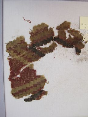 Ica. <em>Textile Fragment, Undetermined</em>, 1000-1400. Textile. Camelid fiber, 9 5/8 × 9 1/8 in. (24.4 × 23.2 cm). Brooklyn Museum, Gift of Kay Hodnett Nunez, 1995.47.99. Creative Commons-BY (Photo: , CUR.1995.47.99.jpg)