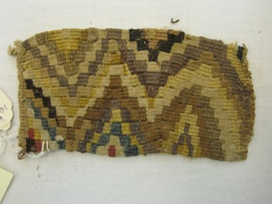<em>Textile Fragment, Undetermined</em>, 1400-1532. Cotton, camelid fiber, 5 5/16 x 2 15/16in. (13.5 x 7.5cm). Brooklyn Museum, Gift of Kay Hodnett Nunez, 1995.84.16. Creative Commons-BY (Photo: Brooklyn Museum, CUR.1995.84.16.jpg)