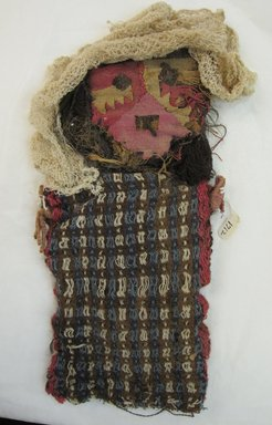 Chancay. <em>Funerary Doll</em>, 1400-1532. Cotton, camelid fiber, straw, 12 1/4 × 6 1/2 × 1 in. (31.1 × 16.5 × 2.5 cm). Brooklyn Museum, Gift of Kay Hodnett Nunez, 1995.84.4. Creative Commons-BY (Photo: Brooklyn Museum, CUR.1995.84.4.jpg)