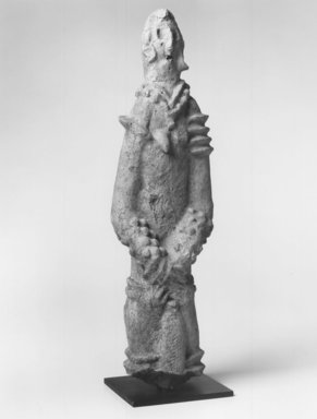 <em>Standing Female Figure</em>, ca. 1300. Terracotta, 18 x 5 1/2 x 3 1/4 in. (45.7 x 14.0 x 8.2 cm). Brooklyn Museum, Gift of Joseph and Margaret Knopfelmacher, 1996.170.18. Creative Commons-BY (Photo: Brooklyn Museum, CUR.1996.170.18_print_threequarter_bw.jpg)