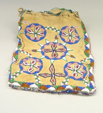 Plains. <em>Beaded Bag with Drawstring</em>, early 20th century. Hide, beads, cotton thread, L: 11 in. W: 7 3/4 in. Brooklyn Museum, Gift of Betsy Stern, 1996.172.2. Creative Commons-BY (Photo: Brooklyn Museum, CUR.1996.172.2_view2.jpg)