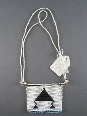 Xhosa. <em>Neck Ornament (Iphoco)</em>, 1930s-1940s. Glass seed beads, fiber, 3 3/4 x 3 1/8 in. (9.5 x 7.9 cm). Brooklyn Museum, Gift of Mr. and Mrs. Lee Lorenz, 1996.202.16. Creative Commons-BY (Photo: Brooklyn Museum, CUR.1996.202.16_overall.jpg)