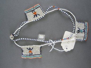 Xhosa (Thembu subgroup). <em>Neck Ornament (Iphoco)</em>, 1930s-1940s. Glass seed beads, fiber, 2 1/8 x 1 1/2 in. (5.4 x 3.8 cm). Brooklyn Museum, Gift of Mr. and Mrs. Lee Lorenz, 1996.202.17. Creative Commons-BY (Photo: Brooklyn Museum, CUR.1996.202.17_overall.jpg)