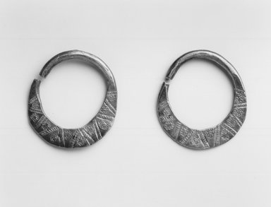 Swahili. <em>Pair of Earrings</em>, mid-20th century. Silver?, 1 1/4 x 1 3/8 in. (3.2 x 3.5 cm). Brooklyn Museum, Gift of Donna Klumpp Pido, 1996.204.11a-b. Creative Commons-BY (Photo: Brooklyn Museum, CUR.1996.204.11a-b_print_bw.jpg)