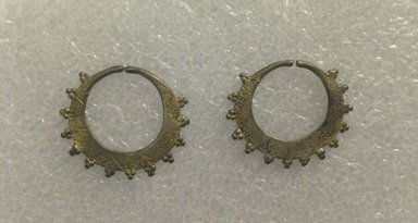Amhara. <em>Pair of Earrings</em>, mid-20th century. Copper alloy, 1 1/2 x 1 7/8 in. (3.8 x 4.8 cm). Brooklyn Museum, Gift of Donna Klumpp Pido, 1996.204.20a-b. Creative Commons-BY (Photo: Brooklyn Museum, CUR.1996.204.20a-b_overall.jpg)
