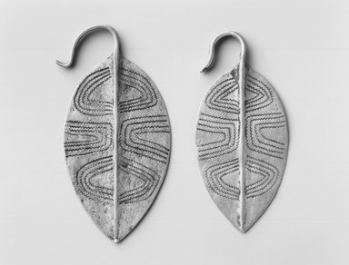 Turkana. <em>Earring (Akaparaparat)</em>, mid-20th century. Aluminum, 2 3/4 x 1 1/8 in. (7.0 x 2.9 cm). Brooklyn Museum, Gift of Donna Klumpp Pido, 1996.204.32. Creative Commons-BY (Photo: Brooklyn Museum, CUR.1996.204.32_print_bw.jpg)