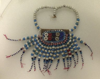 Sidamo. <em>Pendant</em>, mid-20th century. Glass beads, hide, fiber, plastic buttons, 10 1/2 x 6 3/4 in. (26.7 x 17.2 cm). Brooklyn Museum, Gift of Donna Klumpp Pido, 1996.204.35. Creative Commons-BY (Photo: Brooklyn Museum, CUR.1996.204.35_overall.jpg)