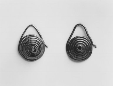 Samburu. <em>Pair of Coiled Earrings</em>, mid-20th century. Copper alloy, 1 1/4 x 1 in. (3.2 x 2.5 cm). Brooklyn Museum, Gift of Donna Klumpp Pido, 1996.204.3a-b. Creative Commons-BY (Photo: Brooklyn Museum, CUR.1996.204.3a-b_print_bw.jpg)