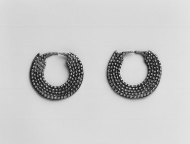 Amhara. <em>Pair of Earrings</em>, mid-20th century. Silver?, Diam.: 7/8 in. (2.2 cm). Brooklyn Museum, Gift of Donna Klumpp Pido, 1996.204.4a-b. Creative Commons-BY (Photo: Brooklyn Museum, CUR.1996.204.4a-b_print_bw.jpg)