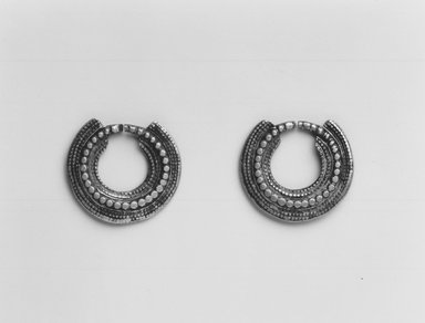 Amhara. <em>Pair of Earrings</em>, mid-20th century. Silver?, diam.: 7/8 in. (2.2 cm). Brooklyn Museum, Gift of Donna Klumpp Pido, 1996.204.8a-b. Creative Commons-BY (Photo: Brooklyn Museum, CUR.1996.204.8a-b_print_bw.jpg)