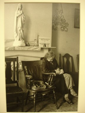 Vivian Cherry (American, 1920-2019). <em>Catholic Workers (Woman Sleeping at Statue of Mary on Shelf Above)</em>, 1955. Gelatin silver photograph (vintage), 10 1/2 x 7 1/4 in. (26.7 x 18.4 cm). Brooklyn Museum, Gift of Steven Schmidt, 1996.241.12. © artist or artist's estate (Photo: Brooklyn Museum, CUR.1996.241.12.jpg)