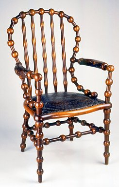 Attributed to George Jacob Hunzinger (American, born Germany, 1835-1898). <em>Armchair</em>, 1890s. Wood, leather, 43 1/4 x 26 x 25 1/4 in. (109.8 x 66.0 x 64.1 cm). Brooklyn Museum, Gift of Norman Mizuno and Alan J. Davidson in memory of Shinko Takeda, Kazu Takeda, Miyo Takeda and Yoshi Takeda, 1996.38a-b. Creative Commons-BY (Photo: Brooklyn Museum, CUR.1996.38a-b_view2.jpg)