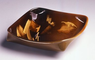 Leona van Briggle (American, active late 19th century -early 20th century). <em>Ashtray</em>, ca.1899. Glazed earthenware, 1 7/8 x 7 x 7 in. (4.8 x 17.8 x 17.8 cm). Brooklyn Museum, Gift of Helen Mandelbaum, 1996.86. Creative Commons-BY (Photo: Brooklyn Museum, CUR.1996.86.jpg)