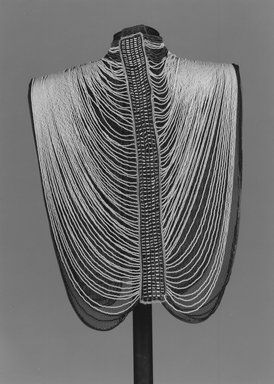 Dinka. <em>Woman's vest (alual)</em>, 20th century. Glass beads, fiber, fabric, wire, mounted: 30 1/2 × 20 × 4 1/2 in. (77.5 × 50.8 × 11.4 cm). Brooklyn Museum, Carll H. de Silver Fund, 1997.1.3. Creative Commons-BY (Photo: Brooklyn Museum, CUR.1997.1.3_print_bw.jpg)