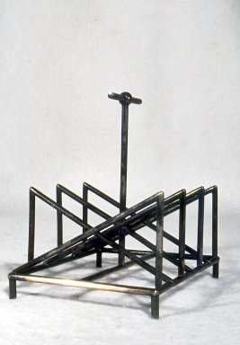 Christopher Dresser (English, 1834-1904). <em>Toast Rack</em>, ca. 1880. Silverplate, 5 3/8 x 5 1/4 x 4 1/4 in. (13.7 x 13.3 x 10.8 cm). Brooklyn Museum, Gift of Marie Bernice Bitzer, by exchange, 1997.114. Creative Commons-BY (Photo: Brooklyn Museum, CUR.1997.114.jpg)