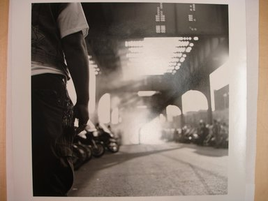 Martin Dixon (American, born 1965). <em>The Drag Strip, Livonia Avenue, Brooklyn, N.Y.</em>, 1993. Gelatin silver photograph, image: 9 x 9 in. (22.8 x 22.8 cm). Brooklyn Museum, Purchased with funds given by Karen B. Cohen, 1997.17. © artist or artist's estate (Photo: Brooklyn Museum, CUR.1997.17.jpg)