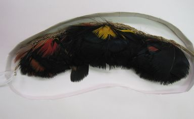 Machiguinga. <em>Ornament</em>, 20th century. Feathers, twine, 2 1/4 × 3/8 × 7 3/4 in. (5.7 × 1 × 19.7 cm), not including ties. Brooklyn Museum, Gift of Nobuko Kajitani, 1997.57.6. Creative Commons-BY (Photo: , CUR.1997.57.6.jpg)