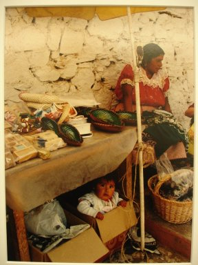 Vivian Cherry (American, 1920-2019). <em>Isla de Janitzia - Infant Under Table</em>, 1995. Chromogenic dye coupler photograph, sheet:  9 3/4 x 8 in.  (24.8 x 20.3 cm);. Brooklyn Museum, Gift of Steven Schmidt, 1998.10.1. © artist or artist's estate (Photo: Brooklyn Museum, CUR.1998.10.1.jpg)