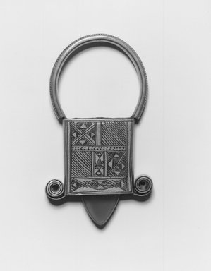 Tuareg. <em>Pendant Cross of In Gall</em>, early 20th century. Silver, plastic, wax, 3 1/8 x 3/4 x 1 3/4 in.  (7.9 x 1.9 x 4.5 cm). Brooklyn Museum, Gift of Mark S. Rapoport, M.D. and Jane C. Hughes, 1998.12.5. Creative Commons-BY (Photo: Brooklyn Museum, CUR.1998.12.5_print_bw.jpg)