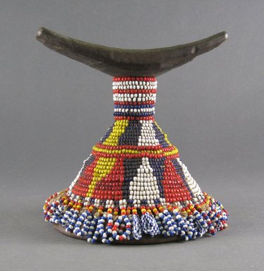 Sidamo. <em>Headrest</em>, 20th century. Wood, glass beads, cotton, 5 3/8 x 5 1/4 x 5 1/2 in.  (13.7 x 13.3 x 14.0 cm). Brooklyn Museum, Gift of Serge and Jodie Becker-Patterson, 1998.124.6. Creative Commons-BY (Photo: Brooklyn Museum, CUR.1998.124.6_front.jpg)