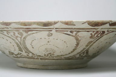 <em>Basin with painted figures and scripts</em>, early 13th century. Ceramic lustreware, 4 5/8 x 18 1/8 in. (11.7 x 46 cm). Brooklyn Museum, Gift of Mr. and Mrs. Paul E. Manheim, 1998.77.1. Creative Commons-BY (Photo: Brooklyn Museum, CUR.1998.77.1_detail1.jpg)