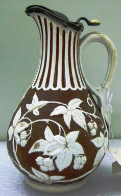 <em>Pitcher</em>, ca. 1865. Glazed stoneware, 8 x 4 1/2 x 4 1/2 in.  (20.3 x 11.4 x 11.4 cm). Brooklyn Museum, Gift of Jason and Susanna Berger, 1999.103.16. Creative Commons-BY (Photo: Brooklyn Museum, CUR.1999.103.16_side1.jpg)