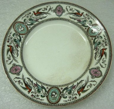 Ridgway, Sparks, & Ridgway. <em>Plate, Chelsea Pattern</em>, 1875-1879; Patented May 31 1875. Glazed earthenware, 1 x 8 3/8 x 8 3/8 in.  (2.5 x 21.3 x 21.3 cm). Brooklyn Museum, Gift of Jason and Susanna Berger, 1999.103.28. Creative Commons-BY (Photo: Brooklyn Museum, CUR.1999.103.28.jpg)