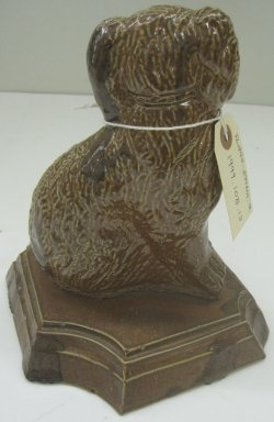 Unknown. <em>Dog-Shaped Doorstop</em>, 19th or 20th century. Glazed earthenware, 9 1/2 x 8 x 6 1/2 in. (24.1 x 20.3 x 16.5 cm). Brooklyn Museum, Gift of Paul F. Walter, 1999.108.13. Creative Commons-BY (Photo: Brooklyn Museum, CUR.1999.108.13_back.jpg)