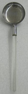 Russel Wright (American, 1904-1976). <em>Shallow Serving Spoon,  from a Five Piece Set of Serving Utensils</em>, ca. 1935. Stainless steel and Lucite, 3 x 14 1/4 x 4 in. (7.6 x 36.2 x 10.2 cm). Brooklyn Museum, Gift of Paul F. Walter, 1999.108.31. Creative Commons-BY (Photo: Brooklyn Museum, CUR.1999.108.31.jpg)