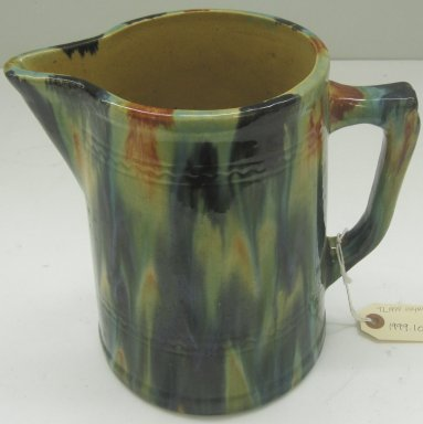 Unknown. <em>Pitcher</em>, 19th or 20th century. Glazed earthenware, 8 1/2 x 9 x 5 1/2 in. (21.6 x 22.9 x 14 cm). Brooklyn Museum, Gift of Paul F. Walter, 1999.108.5. Creative Commons-BY (Photo: Brooklyn Museum, CUR.1999.108.5.jpg)