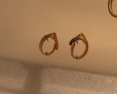 Sumerian. <em>Hoop Earring</em>, ca. 2600-2500 B.C.E. Gold, Diam. 7/16 in. (1.1 cm). Brooklyn Museum, Purchased with funds given by Shelby White, 1999.109.9. Creative Commons-BY (Photo: , CUR.1999.109.8_1999.109.9_kev09.jpg)