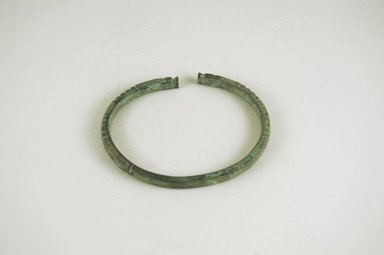Inland Niger Delta. <em>Bracelet</em>, 200-1000 C.E.?. Copper alloy, 1/4 x 3 5/8 x 2 7/8 in.  (0.6 x 9.2 x 7.3 cm). Brooklyn Museum, Gift of Drs. John I. and Nicole Dintenfass, 1999.131.2. Creative Commons-BY (Photo: Brooklyn Museum, CUR.1999.131.2_PS5.jpg)