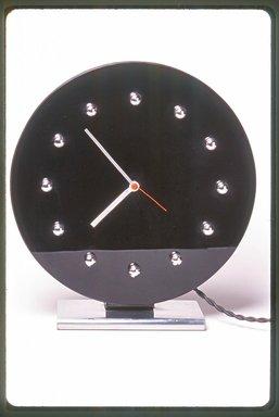 Gilbert Rohde (American, 1894-1944). <em>Clock, Model 4708</em>, ca. 1933. Glass, nickel-plated metal, 10 5/8 x 10 x 3 1/2 in. (27 x 25.4 x 8.9 cm). Brooklyn Museum, Gift of Paul F. Walter, 1999.141.1. Creative Commons-BY (Photo: Brooklyn Museum, CUR.1999.141.1.jpg)