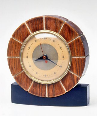 Howard Miller Clock Co. (founded 1926). <em>Clock</em>, ca. 1935. Metal, wood and glass, 6 3/4 x 6 x 1 7/8 in.  (17.1 x 15.2 x 4.8 cm). Brooklyn Museum, Gift of Paul F. Walter, 1999.141.7. Creative Commons-BY (Photo: Brooklyn Museum, CUR.1999.141.7.jpg)