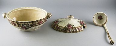 """Barkers & Kent, Ltd.. <em>Covered Sauceboat and Ladle, """"Garfield,""""</em> 1889-1898. Glazed earthenware, 4 5/8 x 8 3/4 x 4 3/4 in.  (11.7 x 22.2 x 12.1 cm). Brooklyn Museum, Gift of Paul F. Walter, 1999.29.52a-c. Creative Commons-BY (Photo: Brooklyn Museum, CUR.1999.29.52a-c_view1.jpg)"""