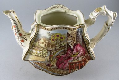 "<em>Teapot, ""Geisha,""</em> Registered (shape)1898; Registered (design)1899. Glazed earthenware, 7 x 9 1/2 x 5 1/2 in.  (17.8 x 24.1 x 14.0 cm). Brooklyn Museum, Gift of Paul F. Walter, 1999.29.57a-b. Creative Commons-BY (Photo: Brooklyn Museum, CUR.1999.29.57a.jpg)"