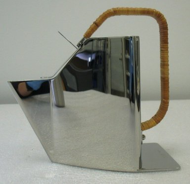 Richard Sapper (German, 1932-2016). <em>'Automatic' Teapot, 'Bandung,' Model 90048</em>, Designed 1987. Stainless steel and straw, 8 3/16 x 8 7/16 x 4 13/16 in.  (20.8 x 21.5 x 12.3 cm). Brooklyn Museum, Gift of Alessi S.p.A., 1999.40.53. Creative Commons-BY (Photo: Brooklyn Museum, CUR.1999.40.53.jpg)