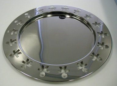 Stefano Giovannoni (Italian, born 1954). <em>Round Tray, 'Girotondo,' Model KKGT</em>, designed 1989-1990. Stainless steel, diameter: (40.0 cm). Brooklyn Museum, Gift of Alessi S.p.A., 1999.40.55. Creative Commons-BY (Photo: Brooklyn Museum, CUR.1999.40.55_view1.jpg)