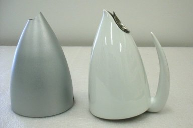 "Philippe Starck (French, born 1949). <em>Teapot, ""Ti-Tang,""</em> Designed 1991-1992. Porcelain, aluminum and epoxy resin, 8 11/16 x 7 1/16 x 5 1/2 in.  (22.0 x 18.0 x 14.0 cm). Brooklyn Museum, Gift of Alessi S.p.A., 1999.40.57. Creative Commons-BY (Photo: Brooklyn Museum, CUR.1999.40.57_view2.jpg)"