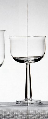 "Ettore Sottsass Jr. (Italian, born Austria, 1917-2007). <em>Glass for White and Rosé Wine, ""Ginevra"" Pattern, Model TCES 1/2</em>, Designed 1996. Colorless glass, 5 5/16 x 3 1/8 in.  (13.5 x 8.0 cm). Brooklyn Museum, Gift of Alessi S.p.A., 1999.40.64. Creative Commons-BY (Photo: Brooklyn Museum, CUR.1999.40.64.jpg)"