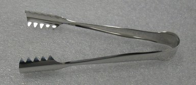 Luigi Massoni. <em>Ice Tongs</em>, designed 1952. Stainless steel, 3/4 x 3 x 6 1/4 in. (1.9 x 7.6 x 15.9 cm). Brooklyn Museum, Gift of Alessi S.p.A., 1999.40.9. Creative Commons-BY (Photo: Brooklyn Museum, CUR.1999.40.9.jpg)
