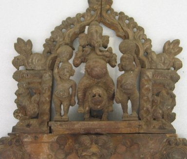 <em>Side Panel of Cradle (Ganesha)</em>, 18th century. Ganesh wood, 25 1/2 x 16 1/2 in.  (64.8 x 41.9 cm). Brooklyn Museum, Gift of Dr. Bertram H. Schaffner, 1999.99.11. Creative Commons-BY (Photo: Brooklyn Museum, CUR.1999.99.11_detail1.jpg)