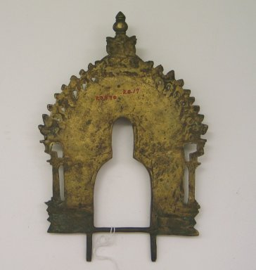 Jain. <em>Small Perforated Arched Screen for an Image of Brass</em>, 18th century. Brass, 10 1/8 x 6 11/16 in. (25.7 x 17 cm). Brooklyn Museum, Robert B. Woodward Memorial Fund, 20.17. Creative Commons-BY (Photo: Brooklyn Museum, CUR.20.17_back.jpg)