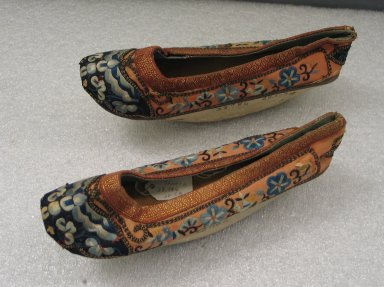 <em>Pair of  Woman's Shoes</em>, 19th century. Wood, silk, 3 1/2 x 9 x 2 3/4 in.  (8.9 x 22.9 x 7 cm). Brooklyn Museum, Gift of E. J. Staber, 20.5. Creative Commons-BY (Photo: Brooklyn Museum, CUR.20.5_side.jpg)