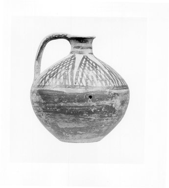 Possibly Greek. <em>One of Three Round Jugs with Narrow Neck and Loop Handle</em>, late 8th-early 7th century B.C.E. Clay, slip, 4 15/16 x Diam. 3 13/16 in. (12.6 x 9.7 cm). Brooklyn Museum, Bequest of Samuel E. Haslett, 20.965.1. Creative Commons-BY (Photo: Brooklyn Museum, CUR.20.965.1_NegA_print_bw.jpg)