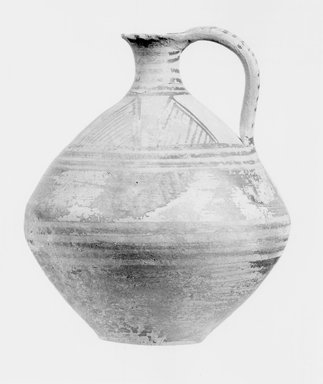 Possibly Greek. <em>One of Three Round Jugs with Narrow Neck and Loop Handle</em>, late 8th-early 7th century B.C.E. Terracotta, pigment, 5 7/16 x Diam. 4 5/8 in. (13.8 x 11.7 cm). Brooklyn Museum, Bequest of Samuel E. Haslett, 20.965.3. Creative Commons-BY (Photo: Brooklyn Museum, CUR.20.965.3_NegA_print_bw.jpg)