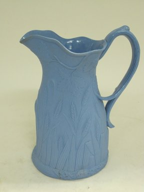 Edward Walley, Villa Pottery (1845-1865). <em>Jug, Ceres Pattern</em>, Patented April 26th 1851. Matte blue stoneware, 7 7/8 x 5 3/4 x 5 1/4 in.  (20.0 x 14.6 x 13.3 cm). Brooklyn Museum, Gift of Gretchen Adkins, 2000.126.4. Creative Commons-BY (Photo: Brooklyn Museum, CUR.2000.126.4_view2.jpg)
