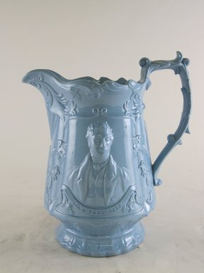 <em>Jug, R. Cobden and R. Peel Pattern</em>, ca. 1839-1846. Blue glazed earthenware, 9 1/8 x 8 1/8 x 5 1/4 in.  (23.2 x 20.6 x 13.3 cm). Brooklyn Museum, Gift of Gretchen Adkins, 2000.126.9. Creative Commons-BY (Photo: Brooklyn Museum, CUR.2000.126.9_view1.jpg)